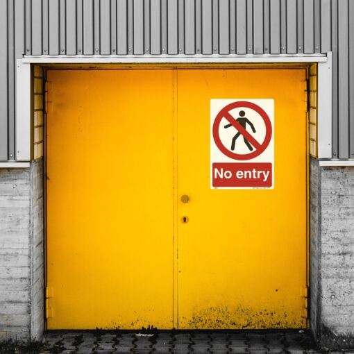 ML017 No Entry Sign on an industrial door.